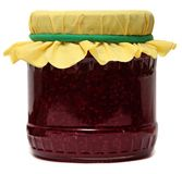 Glass jar with raspberry jam isolated on a white Royalty Free Stock Photography