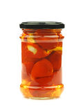 Glass jar with red little sweet peppers Royalty Free Stock Photography