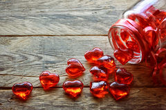 Glass jar with red translucent heart Royalty Free Stock Image