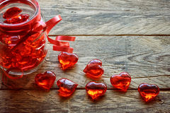 Glass jar with red transparent heart Royalty Free Stock Image