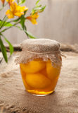 Glass jar with ripe peach compote natural vegetarian dessert food Royalty Free Stock Photography