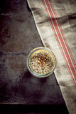 Glass jar of rubbing spices Royalty Free Stock Photography