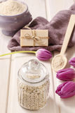 Glass jar of sea salt on white wooden table Royalty Free Stock Image