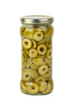 Glass jar with sliced green olives Stock Images