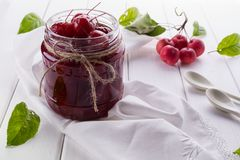 Glass jar of  small paradise apple jam with fresh fruits Royalty Free Stock Images
