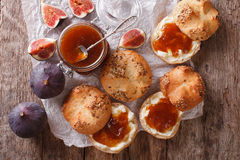 Glass jar with some fig jam and sweet buns close-up. horizontal Royalty Free Stock Photo