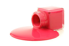 Glass jar spilling magenta paint Stock Photos