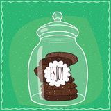 Glass jar with stack of chocolate cookies inside. Large transparent glass jar with stack of round chocolate cookies inside. Cyan background. Handmade cartoon Stock Photo