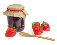 Glass jar of strawberry jam with berries isolated on white backg Royalty Free Stock Photos