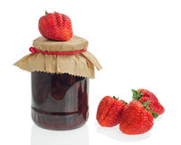 Glass jar of strawberry jam with berries isolated on white backg Stock Photography