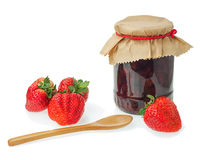 Glass jar of strawberry jam with berries isolated on white backg Royalty Free Stock Photo