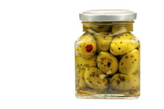 Glass jar with stuffed green olives Royalty Free Stock Photo
