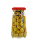 Glass jar with stuffed green olives Royalty Free Stock Photography