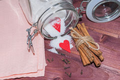 Glass jar with sugar inside decorated with Valentine's heart and cinnamon sticks Stock Photo