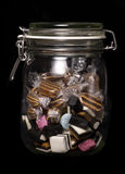 Glass jar of sweets Stock Images