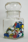 Glass Jar with Thumb Tacks Royalty Free Stock Images