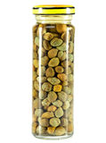 Glass jar with tinned capers.Close up on a white background Royalty Free Stock Photography