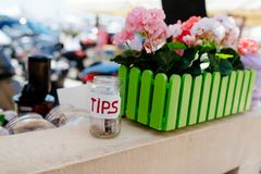 Glass jar for tips. In the roadside bar selling healthy snacks and smoothies royalty free stock photo
