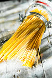 Glass jar of uncooked Italian spaghetti Royalty Free Stock Images