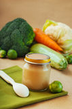 Glass jar with vegetable puree with Brussels sprouts Stock Image