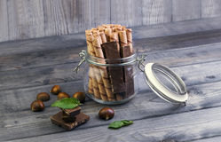 Glass jar with wafer rolls Stock Photos