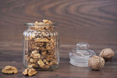Glass jar with walnuts Royalty Free Stock Images