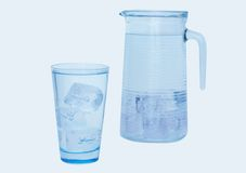 Glass and jar of water Royalty Free Stock Images