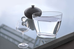 Glass jar of water. Photo of glass  jar of water with empty glass on table ready for to start enjoying wine Stock Photos