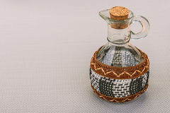 Glass jar with wicker elements Stock Photos