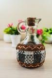 Glass jar with wicker elements Stock Photo
