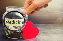 Free Glass Jar With Coins And The Inscription `Medicine`. The Concept Of Family Medicine Insurance, Healthcare. Medical Expenses. Distr Stock Image - 134115591