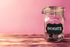 Free Glass Jar With Coins With Chalk Tag Donate On A Pink Background. Donation And Charity Concept. Copy Space Stock Image - 189730791