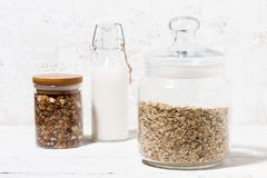 Glass Jar With Oat Flakes, Granola And Bottle Of Milk, Closeup Stock Photos