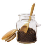 Glass jar with a wooden spoon Royalty Free Stock Image