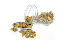 Glass jar woth pistachio in it Stock Photos