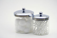 Glass jars. Two glass jars with cotton balls and swabs Royalty Free Stock Images
