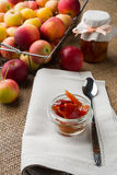 Glass jars of apple confiture Royalty Free Stock Image