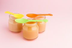 Glass jars of baby food Royalty Free Stock Photo