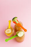 Glass jars of baby food Royalty Free Stock Photography