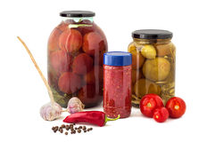 Glass jars of canned tomatoes Royalty Free Stock Photos