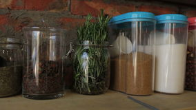 Glass jars with cereals and spices, close-up stock video