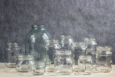 Glass jars. Clear glass jars on the background Royalty Free Stock Photo