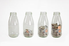 Glass jars with coins like diagram, isolated - savings concept Stock Photos
