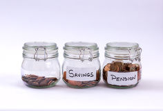 Glass Jars with coins royalty free stock photos