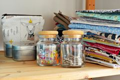 Free Glass Jars, Colorful Clips, Metal Pins And Cotton Fabrics Stock Images - 142061154