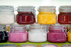 Glass jars with colorful jams in a row royalty free stock image