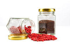 Glass jars of cranberries and spices Royalty Free Stock Images