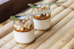 Glass jars with delicious yogurt Royalty Free Stock Photos