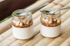 Glass jars with delicious yogurt Stock Image