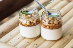 Glass jars with delicious yogurt Stock Images
